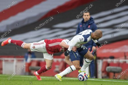 Cedric Soares of Arsenal rugby tackles Lucas Moura of Tottenham Hotspur