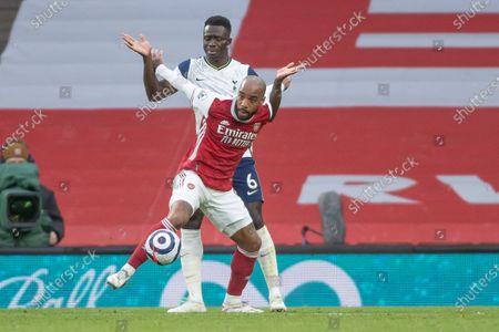 Alexandre Lacazette of Arsenal holds off Davinson Sanchez of Tottenham Hotspur