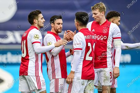 (L-R) Dusan Tadic, Nicolas Tagliafico, Lisandro Martinez and Per Schuurs of Ajax celebrate the 0-2 lead during the Dutch Eredivisie match between PEC Zwolle and Ajax Amsterdam in Zwolle, the Netherlands, 14 March 2021.