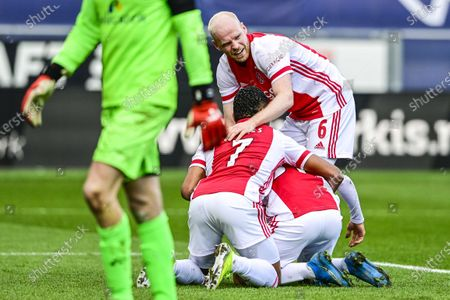 (L-R) David Neres, Nicolas Tagliafico and Davy Klaassen of Ajax celebrate the 2-0 lead during the Dutch Eredivisie match between PEC Zwolle and Ajax Amsterdam in Zwolle, the Netherlands, 14 March 2021.