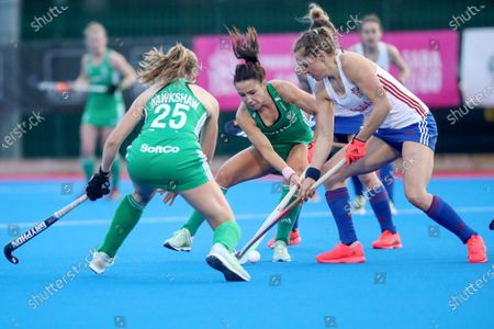 Stock Photo of Ireland vs Great Britain. Ireland's Anna O'Flanagan and Giselle Ansley of Great Britain