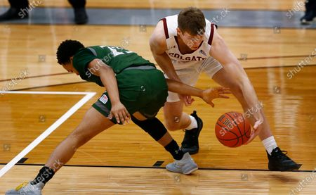 Colgate's Tucker Richardson (15) battles Loyola (Md.) Kenny Jones (25) for a loose ball during an NCAA college basketball game in the finals of the Patriot League tournament, in Hamilton, N.Y