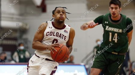 Colgate's Nelly Cummings (0) drives past Loyola (Md.) Alonso Faure (14) during an NCAA college basketball game in the finals of the Patriot League tournament, in Hamilton, N.Y