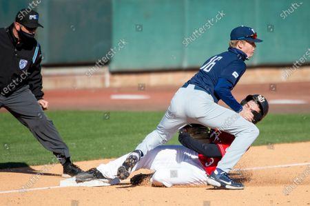 Brigham Young University Jacob Rogers (16) tags out University of Utah Matt Richardson (3) during an NCAA baseball game on in Salt Lake City