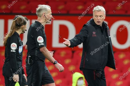 Stock Picture of West Ham's manager David Moyes, right, gestures as he talks to match referee Chris Kavanagh following the English Premier League soccer match between Manchester United and West Ham United at Old Trafford, Manchester, England