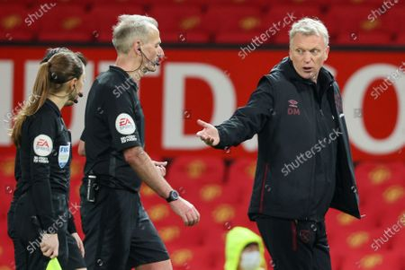Stock Photo of West Ham's manager David Moyes, right, gestures as he talks to match referee Chris Kavanagh following the English Premier League soccer match between Manchester United and West Ham United at Old Trafford, Manchester, England