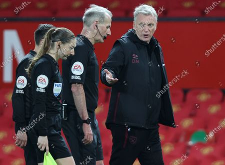 Stock Image of West Ham's manager David Moyes (R) argues with referee Martin Atkinson (2-R) at the end of the English Premier League soccer match between Manchester United and West Ham United in Manchester, Britain, 14 March 2021.