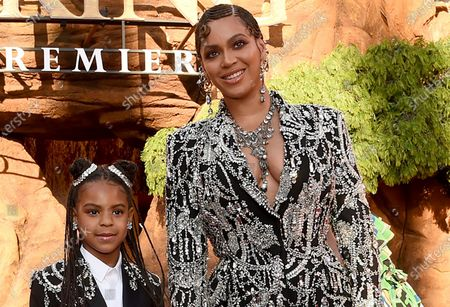 """Beyonce, right, and her daughter Blue Ivy Carter arrive at the world premiere of """"The Lion King"""" in Los Angeles on . Blue Ivy's name was added to the nominee list for best music video for her mother's """"Brown Skin Girl"""