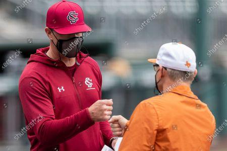 South Carolina head coach Mark Kingston and Texas head coach David Pierce trade lineups at home plate before an NCAA baseball game, in Austin, Texas