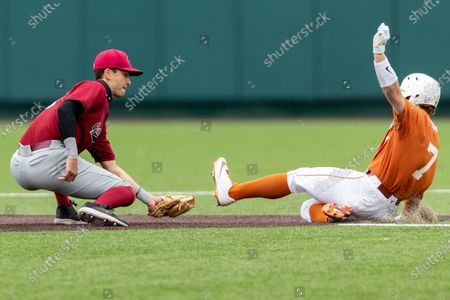 Stock Photo of South Carolina short stop George Callil gets the out on Texas' Douglas Hodo III during an NCAA baseball game, in Austin, Texas