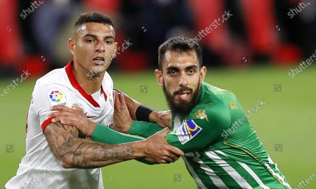 Stock Image of Sevilla's Diego Carlos (L) in action against Betis' Borja Iglesias (R) during the Spanish La Liga soccer match between Sevilla FC and Real Betis at Sanchez Pizjuan stadium in Seville, southern Spain, 14 March 2021.