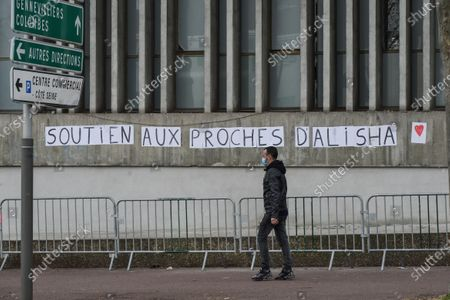 Stock Image of Des mots ont Ã'tÃ' colles sur les murs dans des rues d'Argenteuil, suite au deces d'Alisha. Words were pasted on the walls in the streets of Argenteuil, following the death of Alisha. White march to honor Alisha, teenager from Argenteuil on March 14, 2021. After being beaten and thrown into the Seine by two of her classmates at the Lycee Cognac Jay in Argenteuil, Alisha was found dead on Monday, March 8, 2021. The procession, with her family, and with hundreds of people left from the Lycee Cognac Jay where Alisha was educated, to the Parc des Berges on the banks of the Seine with a speech by her parents.
