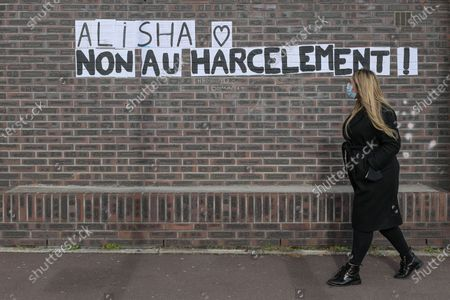 Des mots ont Ã'tÃ' colles sur les murs dans des rues d'Argenteuil, suite au deces d'Alisha. Words were pasted on the walls in the streets of Argenteuil, following the death of Alisha. White march to honor Alisha, teenager from Argenteuil on March 14, 2021. After being beaten and thrown into the Seine by two of her classmates at the Lycee Cognac Jay in Argenteuil, Alisha was found dead on Monday, March 8, 2021. The procession, with her family, and with hundreds of people left from the Lycee Cognac Jay where Alisha was educated, to the Parc des Berges on the banks of the Seine with a speech by her parents.