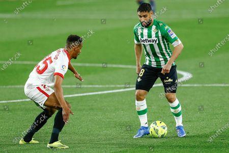 Nabil Fekir of Real Betis and Fernando Reges of Sevilla FC