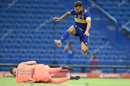 Boca Juniors' Carlos Tevez, right, jumps as River Plate's goalkeeper Franco Armani catches a ball during a local league soccer match at the Bombonera stadium in Buenos Aires, Argentina