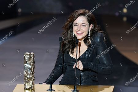"""French actress Laure Calamy celebrates after winning the Best Actress award fot """"Antoinette dans les Cevennes"""" (My Donkey, My Lover and I) at 46th Cesar Film Awards 2021 ceremony at l'Olympia"""