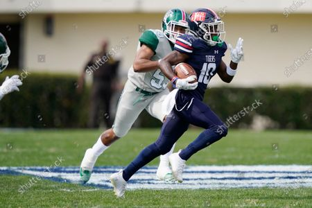 Jackson State punt return specialist Newman Warren (10) runs away from a Mississippi Valley State defender for a long punt return during the first half of an NCAA college football game, in Jackson, Miss