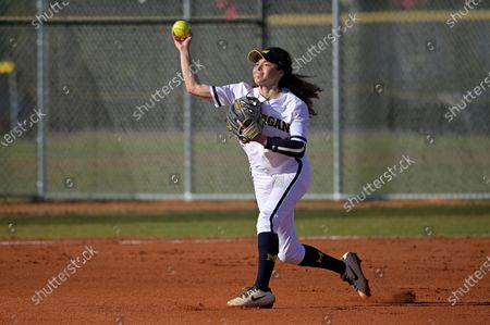 Michigan infielder Natalia Rodriguez (21) throws to first base during an NCAA college softball game against Wisconsin, in Leesburg, Fla