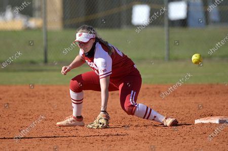 Stock Image of Wisconsin infielder Lauren Foster (24) has a throw get past her during an NCAA college softball game against Michigan, in Leesburg, Fla