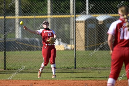 Wisconsin infielder Lauren Foster (24) throws after fielding a ball during an NCAA college softball game against Michigan, in Leesburg, Fla