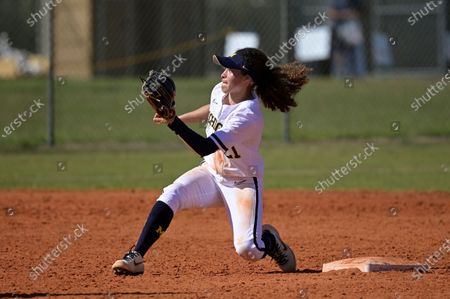 Michigan infielder Natalia Rodriguez (21) waits for a throw from the catcher during an NCAA college softball game against Wisconsin, in Leesburg, Fla