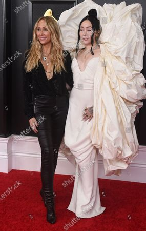 Stock Image of Letitia Cyrus, left, and Noah Cyrus arrive at the 63rd annual Grammy Awards at the Los Angeles Convention Center