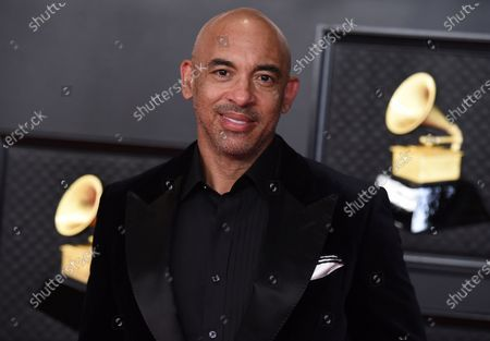 Stock Image of Harvey Mason Jr.., interim president of the Recording Academy, arrives at the 63rd annual Grammy Awards at the Los Angeles Convention Center