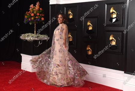 Stock Picture of Mickey Guyton poses on the press line at the 63rd Grammy Awards at the Los Angeles Convention Center on. The award show airs on March 14 with both live and prerecorded segments