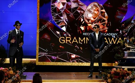 Jimmy Jam, left, and Kenneth Babyface Edmonds appear on stage to present the award for best R&B performance at the 63rd annual Grammy Awards at the Los Angeles Convention Center