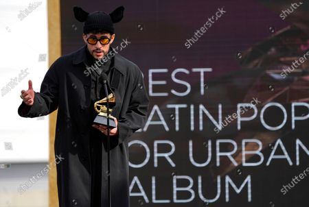"Bad Bunny accepts the award for best latin pop or urban album for ""YHLQMDLG"" at the 63rd annual Grammy Awards at the Los Angeles Convention Center"