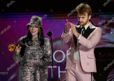 "Billie Eilish, left, and Finneas O'Connell accept the award for record of the year for ""Everything I Wanted"" at the 63rd annual Grammy Awards at the Los Angeles Convention Center on March 14 with both live and prerecorded segments March 14 with both live and prerecorded segments March 14 with both live and prerecorded segments"