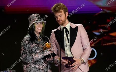 """Billie Eilish, left, and Finneas O'Connell accept the award for record of the year for """"Everything I Wanted"""" at the 63rd annual Grammy Awards at the Los Angeles Convention Center on March 14 with both live and prerecorded segments March 14 with both live and prerecorded segments March 14 with both live and prerecorded segments"""