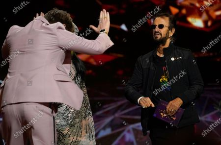 "Finneas O'Connell bows toward presenter Ringo Starr as he goes on stage to accept the award for record of the year for ""Everything I Wanted"" at the 63rd annual Grammy Awards at the Los Angeles Convention Center on March 14 with both live and prerecorded segments March 14 with both live and prerecorded segments"