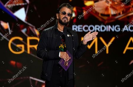 Stock Picture of Ringo Starr presents the award for record of the year at the 63rd annual Grammy Awards at the Los Angeles Convention Center on March 14 with both live and prerecorded segments March 14 with both live and prerecorded segments