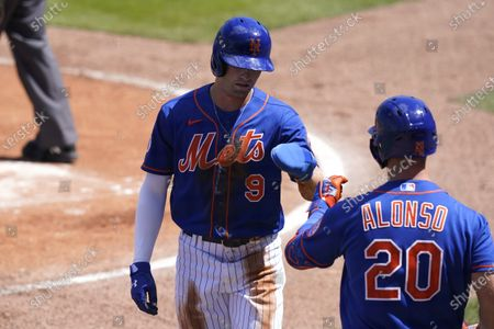 New York Mets' Brandon Nimmo (9) is met by Pete Alonso (20) after scoring during the first inning of a spring training baseball game against the St. Louis Cardinals, in Port St. Lucie, Fla