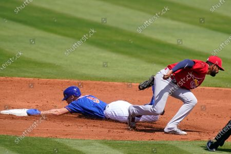 New York Mets' Brandon Nimmo (9) steals second as St. Louis Cardinals' shortstop Jose Rondon takes the throw during the first inning of a spring training baseball game, in Port St. Lucie, Fla