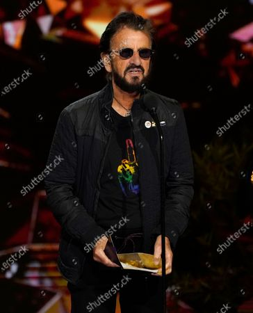 Ringo Starr presents the award for record of the year at the 63rd annual Grammy Awards at the Los Angeles Convention Center