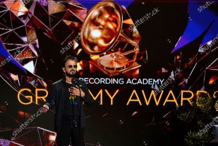 Stock Image of Ringo Starr presents the award for record of the year at the 63rd annual Grammy Awards at the Los Angeles Convention Center