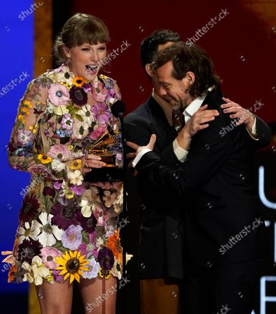 """Stock Photo of Taylor Swift, from left, Jack Antonoff and Aaron Dessner accept the award for album of the year for """"Folklore""""at the 63rd annual Grammy Awards at the Los Angeles Convention Center"""
