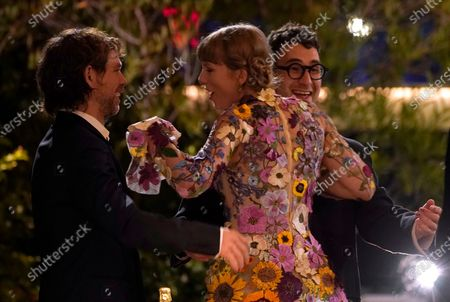 """Aaron Dessner, from left, Taylor Swift and Jack Antonoff react as they announced as winner of the award for album of the year for """"Folklore"""" at the 63rd annual Grammy Awards at the Los Angeles Convention Center"""