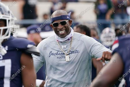 Stock Photo of Jackson State football coach Deion Sanders smiles as he greets his defensive squad after they had recovered a Mississippi Valley State fumble for a touchdown during the second half of an NCAA college football game, in Jackson, Miss