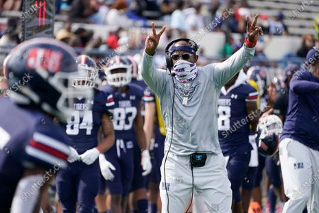 Jackson State football coach Deion Sanders gestures toward his team during the first half of an NCAA college football game against Mississippi Valley State, in Jackson, Miss