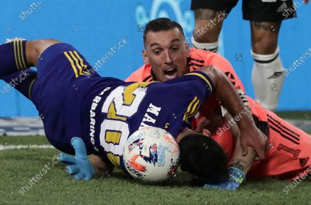 Gonzalo Maroni (L) of Boca vies for the ball with Franco Armani goalkeeper of River during the Argentinian First Division soccer match between Boca Junior and River Plate at La Bombonera stadium in Buenos Aires, Argentina, 14 March 2021.