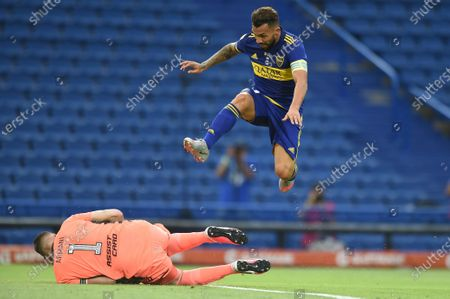 Carlos Tevez (top) of Boca vies for the ball with Franco Armani goalkeeper of River during the Argentinian First Division soccer match between Boca Junior and River Plate at La Bombonera stadium in Buenos Aires, Argentina, 14 March 2021.