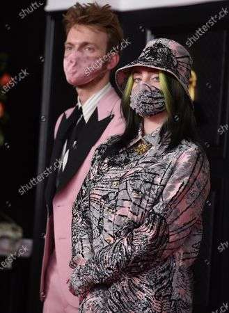 Finneas O'Connell, left, and Billie Eilish arrive at the 63rd annual Grammy Awards at the Los Angeles Convention Center on March 14 with both live and prerecorded segments