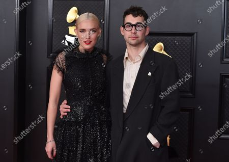 Carlotta Kohl, left, and Jack Antonoff pose in the press room at the 63rd annual Grammy Awards at the Los Angeles Convention Center on March 14 with both live and prerecorded segments