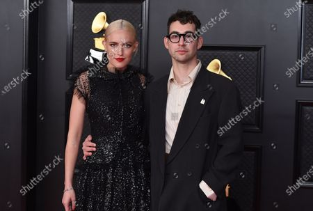 Stock Image of Carlotta Kohl, left, and Jack Antonoff pose in the press room at the 63rd annual Grammy Awards at the Los Angeles Convention Center on March 14 with both live and prerecorded segments