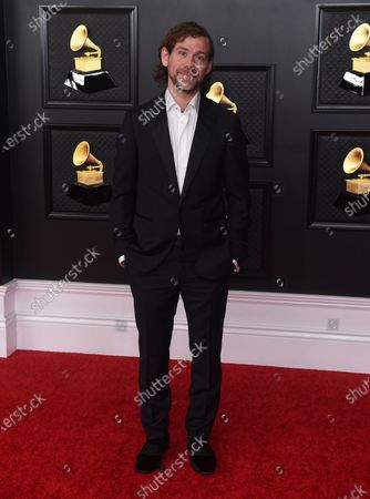 Aaron Dessner poses in the press room at the 63rd annual Grammy Awards at the Los Angeles Convention Center on March 14 with both live and prerecorded segments