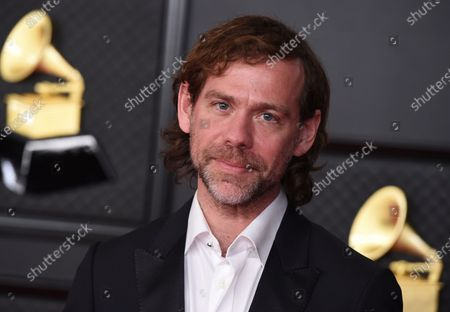 Stock Picture of Aaron Dessner poses in the press room at the 63rd annual Grammy Awards at the Los Angeles Convention Center on March 14 with both live and prerecorded segments
