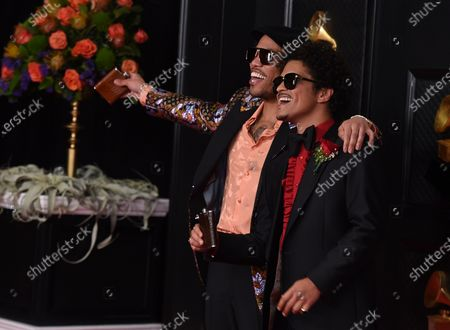 Anderson Paak, left, and Bruno Mars arrive at the 63rd annual Grammy Awards at the Los Angeles Convention Center on March 14 with both live and prerecorded segments